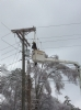 FLEC Lineman Nathan Lunn works on the icy lines to restore the power.